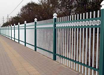 White ornamental aluminum fences with green posts and rails