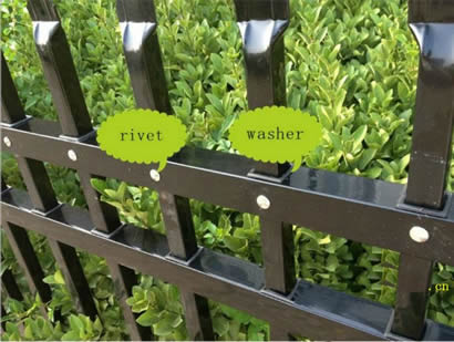 Black ornamental fence with washers between vertical pickets and horizontal rails to prevent water leaking into the tube.