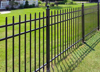 Black ornamental steel fences with pressed spears are used to house security