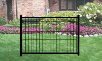 Black ornamental wire fences are placed in front of a house.